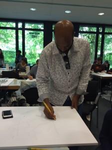 Saleh al Shukairi demonstrating his art work