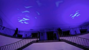 The University main hall illuminated in blue to match up with the event's theme: Water