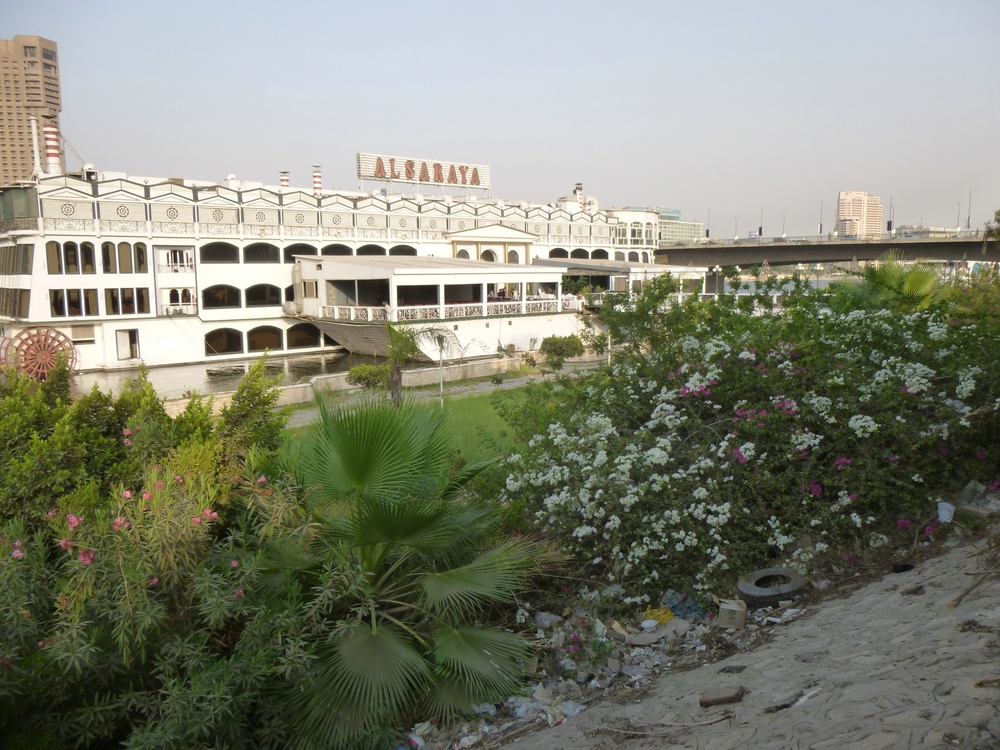 Floating restaurants behind a fenced promenade on El-Gezira
